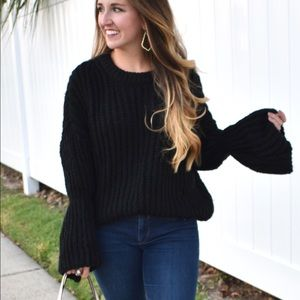 Black, bell-sleeved sweater